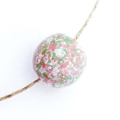 pink with green and with speckle round ball