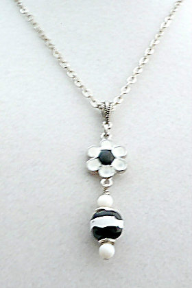 black and white with flower necklace