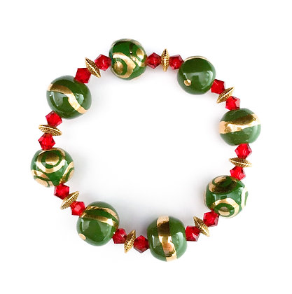 green with gold and red bracelet