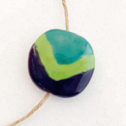green and purple V pita pat