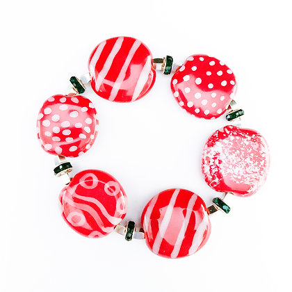 red with white stripes and dots bracelet