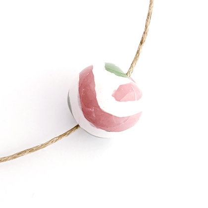 white with pink and green gaby design round ball