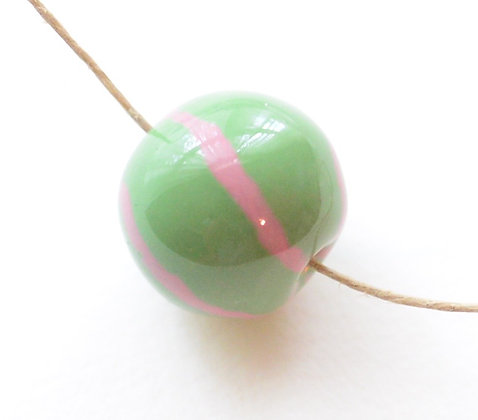 green with pink jazzy stripes round ball