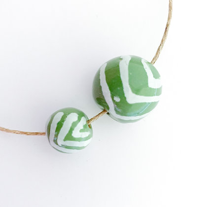 green with white jazzy V's round ball