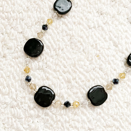 black pita pat necklace or earrings