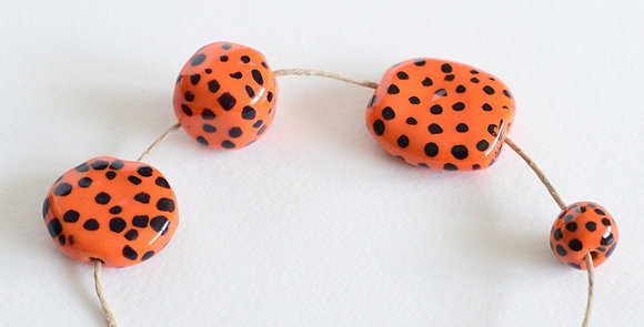 orange with black small dots - assorted