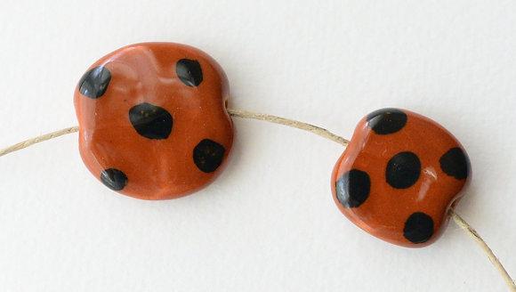 brown with black dots pita pat