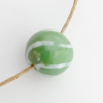 green with white jazzy stripes round ball