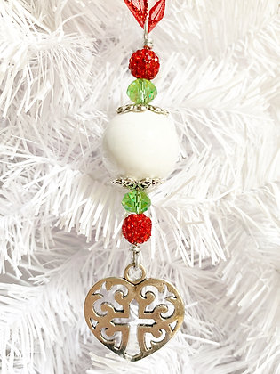 white, red and green cross in heart ornament