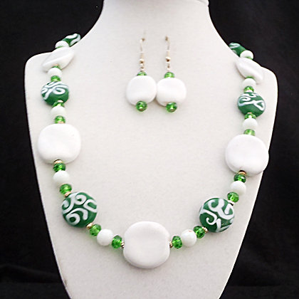 green and white necklace or earrings