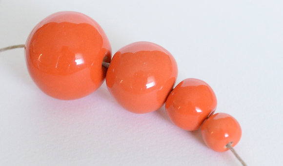orange solid round ball - assorted sizes