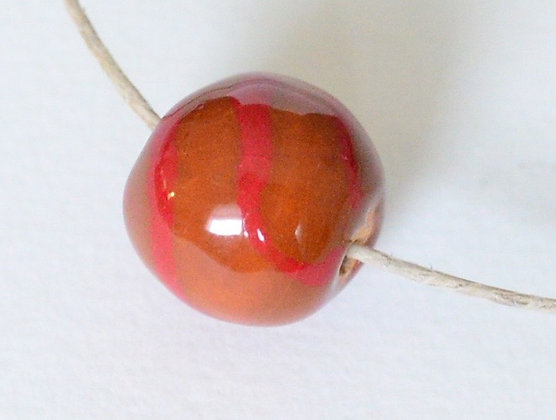 brown with red stripes round ball