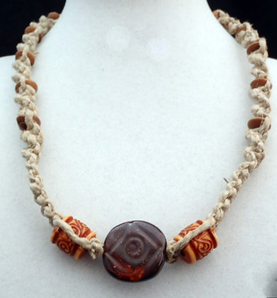 carved brown pita pat macrame necklace