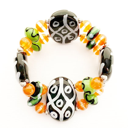 black, orange and green bracelet