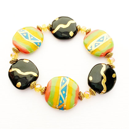 orange, black, yellow, green with gold bracelet