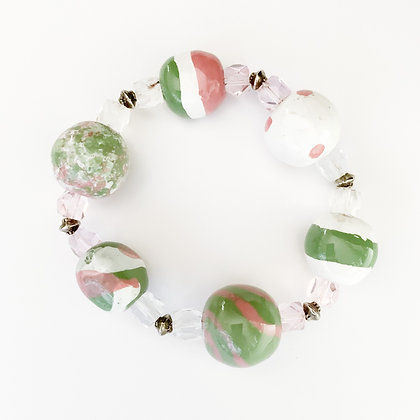 pink, green and white bracelet