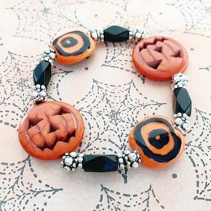 black and orange jack-o-lantern bracelet