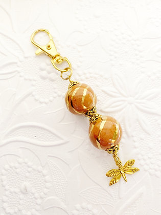 tan striped golden dragonfly purse charm