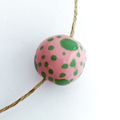 pink with green dots round ball
