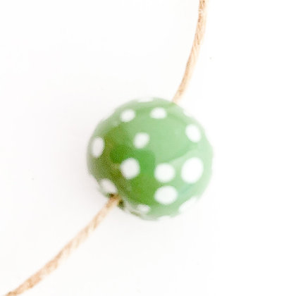 green with white small dots round ball