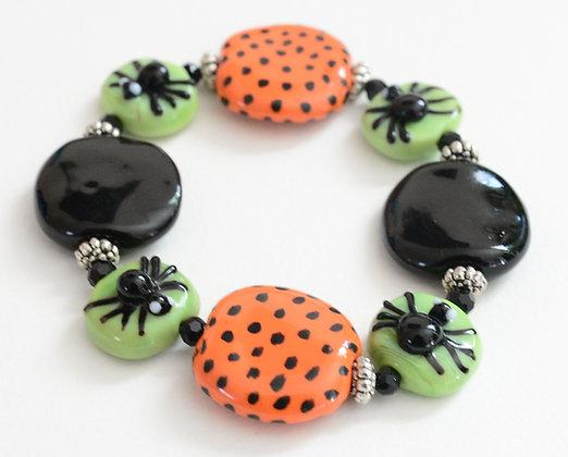 black and orange spider bracelet