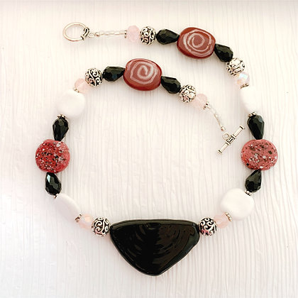 pink, black and white necklace or earrings