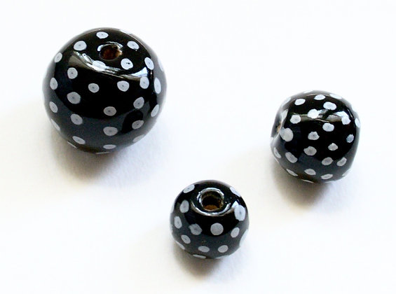 black with white dots round ball