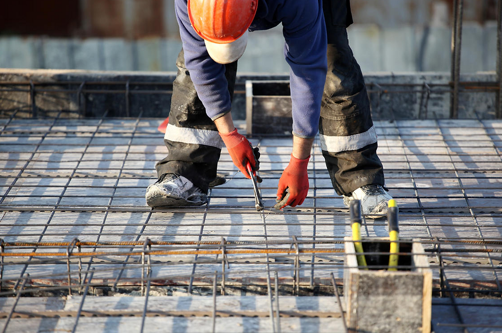 Picture of construction worker preparing for a concrete pour