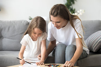 Nanny colouring with a child