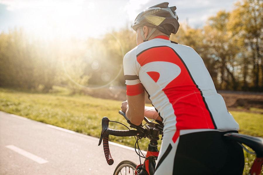male-bycyclist-in-sportswear-cycling-on-bike-path-KJQP2XZ_edited_edited.jpg