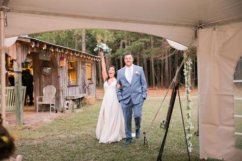 Joyous Couple Enter Receptiom Tent