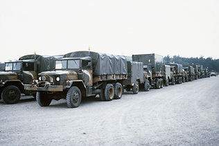 m35a2-2-12-ton-trucks-are-parked-in-a-st