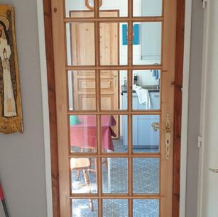 Porte d'intérieur en bois réalisée par la Menuiserie des Rossignols