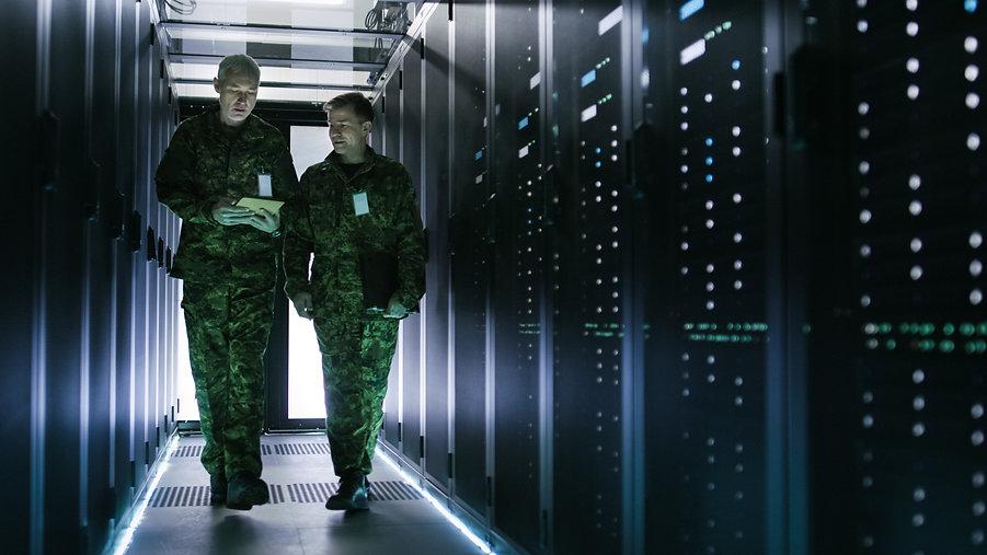 Two Military Men Walking in Data Center