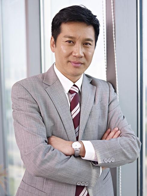 portrait of an asian businessman standin