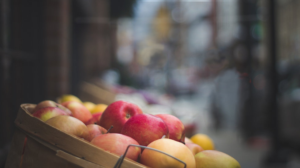 a-basket-of-apples-in-an-outdoor-market.