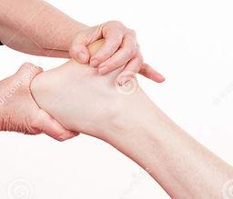 osteopath-doing-reflexology-massage-male