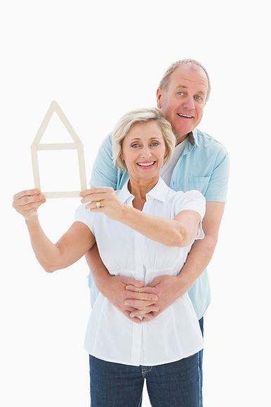 happy-older-couple-holding-house-shape.j