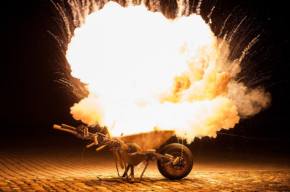 Fireworks exploding in a wheelbarrow