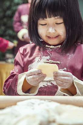 Portrait of little girl making dumplings
