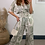 Thumbnail: Olive & Cream Satin Stretch Printed Short Sleeve Jumpsuit With Elasticated Waist