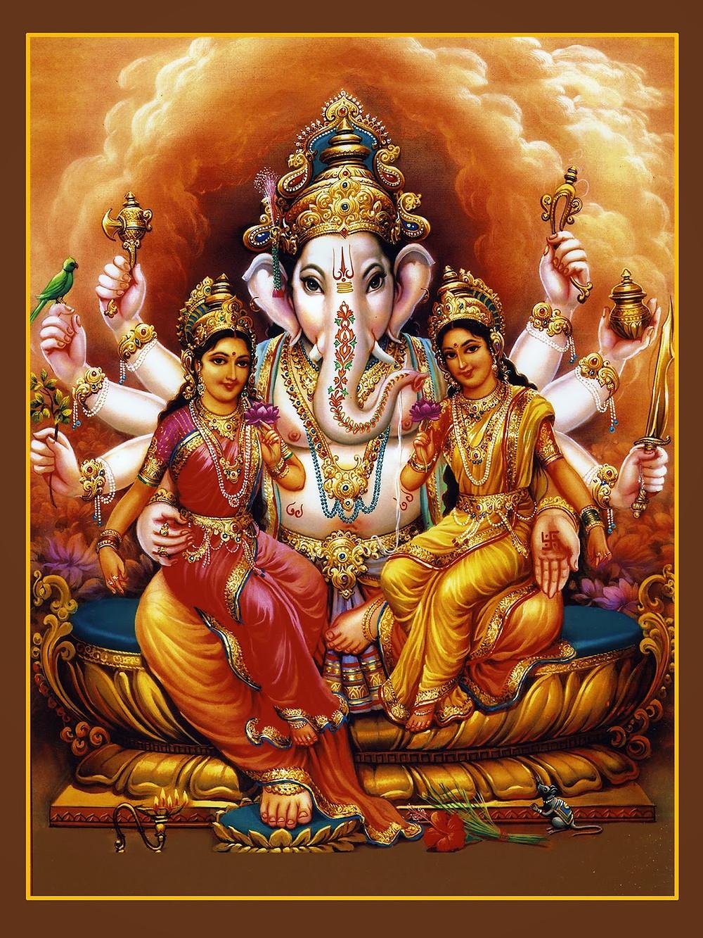 Lord Ganesha with Buddhi and Siddhi.