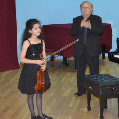 A student violinist acknowledging the audience  (Stepanakert, Nagorno-Karabagh, 2017)