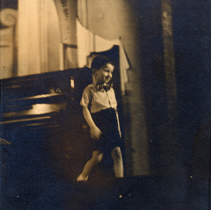 Şahan acknowledging the audience after his first public performance at age four (Istanbul, Turkey, 1948)
