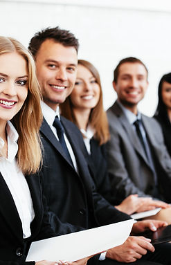 Group-of-happy-business-people-sitting-i