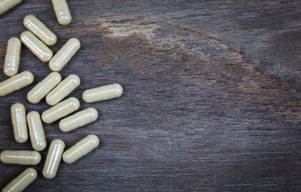 many-capsule-pill-on-wooden-background-0