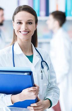 Confident-female-doctor-holding-medical-