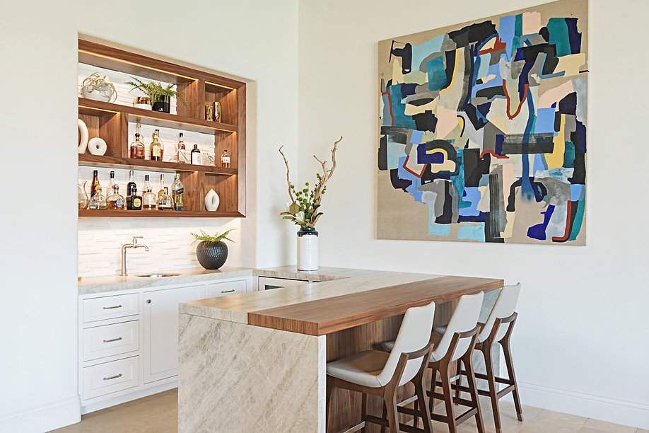 Modern Rancho Santa Fe Remodel. Interior design by Paschall Design. Here you see a built-in and new countertop deisgned for our clients kitchenette and bar. A new built-in was also designed for behind the the bar. Furniture selections were included in the design. Indoor accessories, planters, vases, and more.