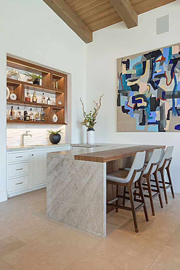 Modern Rancho Santa Fe Remodel. Famous artwork pieces included. Interior design by Paschall Design. Here you see a built-in and new countertop deisgned for our clients kitchenette and bar. Furniture selections were included in the design. Indoor accessories, planters, vases, and more.