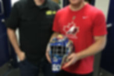 Mario presenting Leo Lazarev of the OHL Barrie Colts with his new goalie mask wrap